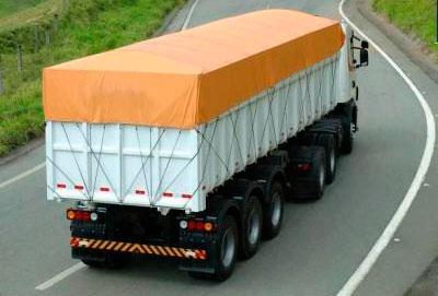 Lonas para camiones toldos guill n for Mecanismos para toldos de lona